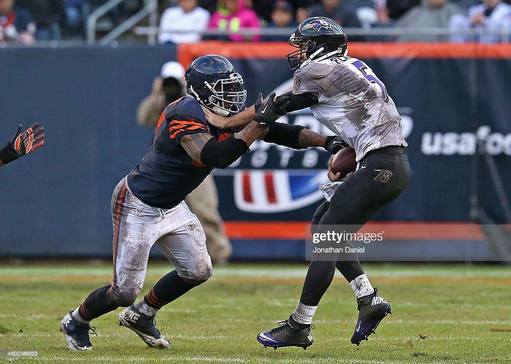<a gi-track='captionPersonalityLinkClicked' href=/galleries/search?phrase=Julius+Peppers&family=editorial&specificpeople=213146 ng-click='$event.stopPropagation()'>Julius Peppers</a> #90 of the Chicago Bears sacks <a gi-track='captionPersonalityLinkClicked' href=/galleries/search?phrase=Joe+Flacco&family=editorial&specificpeople=4645672 ng-click='$event.stopPropagation()'>Joe Flacco</a> #5 of the Baltimore Ravens at Soldier Field on November 17, 2013 in Chicago, Illinois.