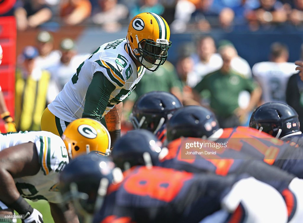 Julius Peppers of the Green Bay Packers awaits the snap against the Chicago Bears at Soldier Field on September 28 2014 in Chicago Illinois The...