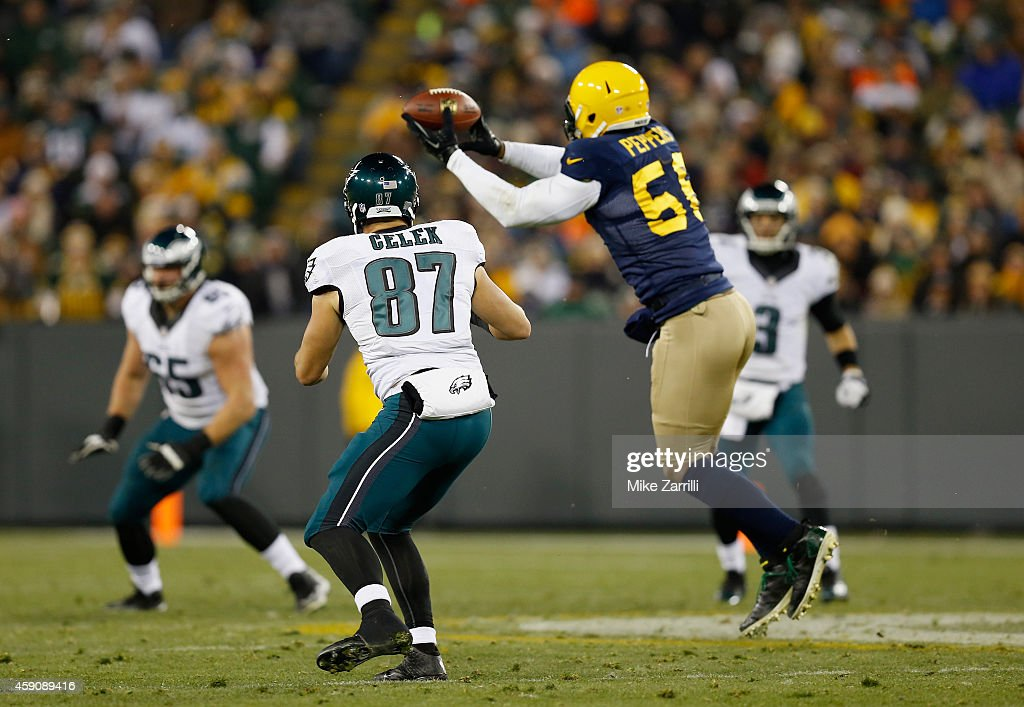 Julius Peppers of the Green Bay Packers catches an interception for a touchdown against the Philadelphia Eagles during the third quarter of the game...