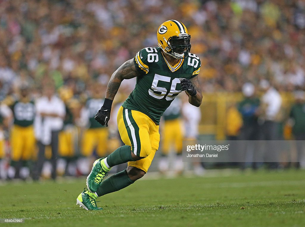 Julius Peppers of the Green Bay Packers rushes against the Oakland Raiders during a preseason game at Lambeau Field on August 22 2014 in Green Bay...