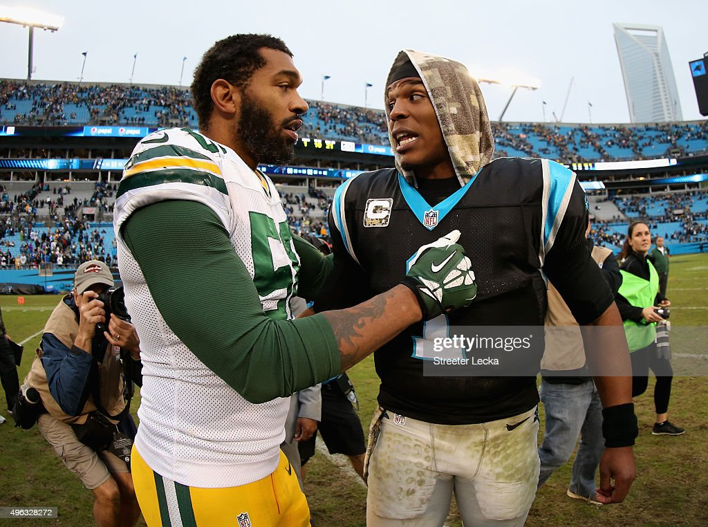 Julius Peppers of the Green Bay Packers talks to Cam Newton of the Carolina Panthers after their game at Bank of America Stadium on November 8 2015...