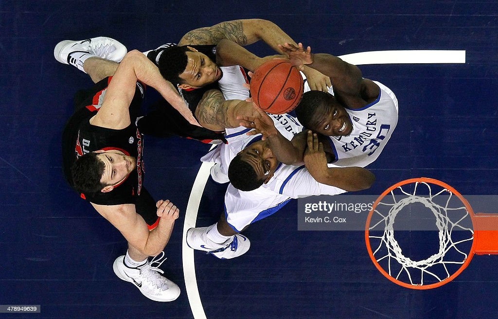<a gi-track='captionPersonalityLinkClicked' href=/galleries/search?phrase=Julius+Randle&family=editorial&specificpeople=10784969 ng-click='$event.stopPropagation()'>Julius Randle</a> #30 and Dakari Johnson #44 of the Kentucky Wildcats battles for a rebound against Marcus Thornton #2 and Nemanja Djurisic #42 of the Georgia Bulldogs during the semifinals of the SEC Men's Basketball Tournament at Georgia Dome on March 15, 2014 in Atlanta, Georgia.