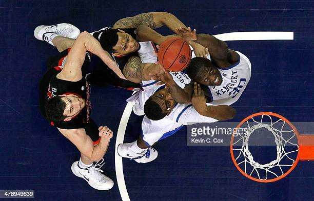 Julius Randle and Dakari Johnson of the Kentucky Wildcats battles for a rebound against Marcus Thornton and Nemanja Djurisic of the Georgia Bulldogs...