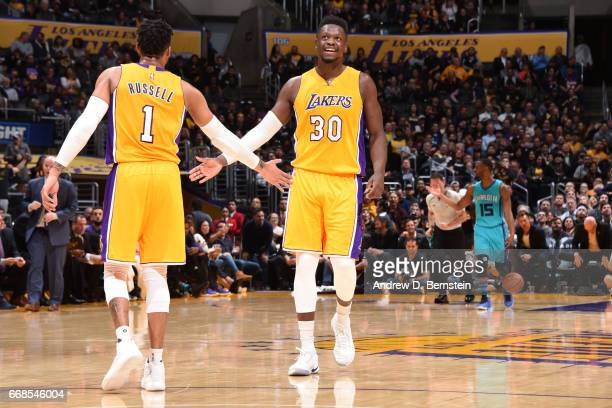 Julius Randle and D'Angelo Russell of the Los Angeles Lakers high five each other during the game against the Charlotte Hornets on February 28 2017...
