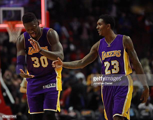 Julius Randle and Louis Williams of the Los Angeles Lakers celebrate a win over the Chicago Bulls at the United Center on November 30 2016 in Chicago...