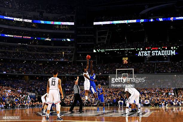 Julius Randle of the Kentucky Wildcats and Phillip Nolan of the Connecticut Huskies jump for the opening tip during the NCAA Men's Final Four...