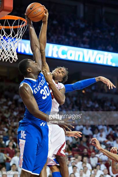 Julius Randle of the Kentucky Wildcats blocks a shot by Michael Qualls of the Arkansas Razorbacks but is called for a foul at Bud Walton Arena on...