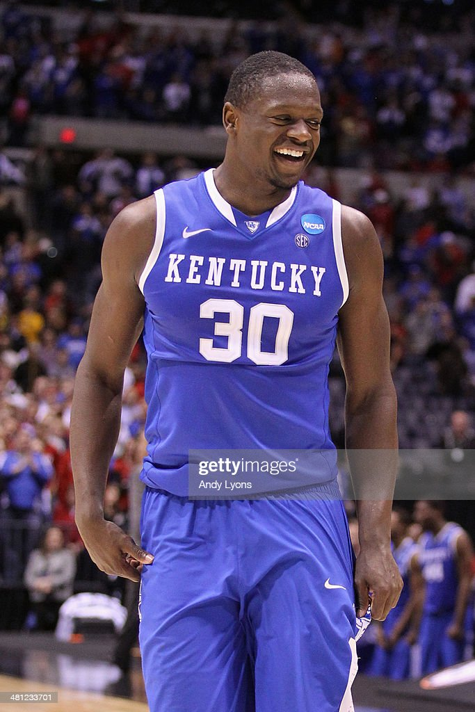 <a gi-track='captionPersonalityLinkClicked' href=/galleries/search?phrase=Julius+Randle&family=editorial&specificpeople=10784969 ng-click='$event.stopPropagation()'>Julius Randle</a> #30 of the Kentucky Wildcats celebrates defeating the Louisville Cardinals 74 to 69 during the regional semifinal of the 2014 NCAA Men's Basketball Tournament at Lucas Oil Stadium on March 28, 2014 in Indianapolis, Indiana.