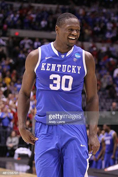 Julius Randle of the Kentucky Wildcats celebrates defeating the Louisville Cardinals 74 to 69 during the regional semifinal of the 2014 NCAA Men's...