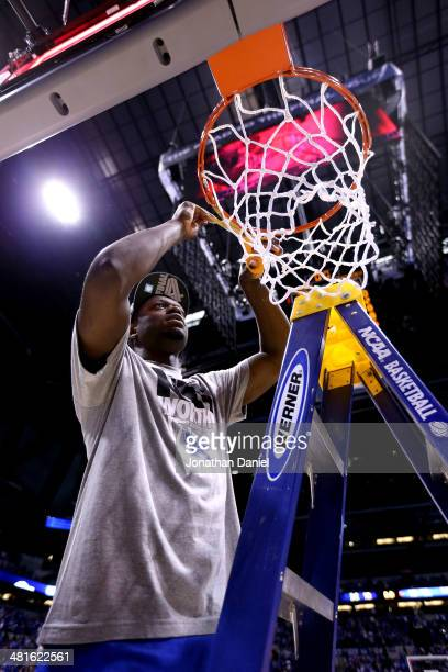 Julius Randle of the Kentucky Wildcats cuts the net after defeating the Michigan Wolverines 75 to 72 in the midwest regional final of the 2014 NCAA...