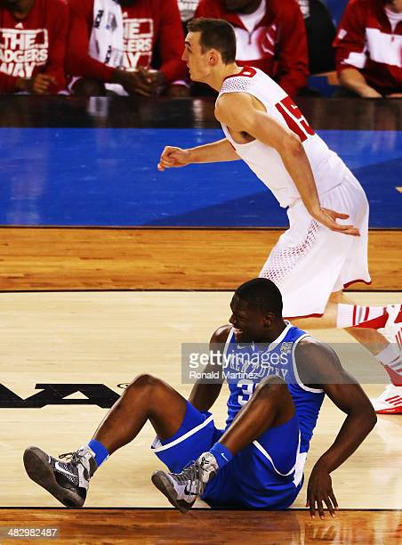 Julius Randle of the Kentucky Wildcats falls to the ground during the NCAA Men's Final Four Semifinal against the Wisconsin Badgers at ATT Stadium on...