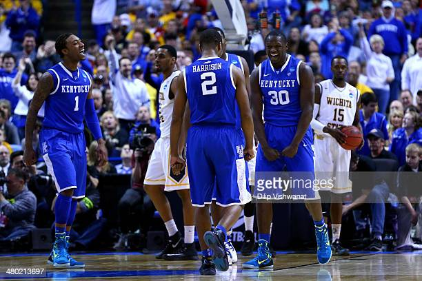 Julius Randle of the Kentucky Wildcats reacts after basket and drawing a foul against the Wichita State Shockers during the third round of the 2014...