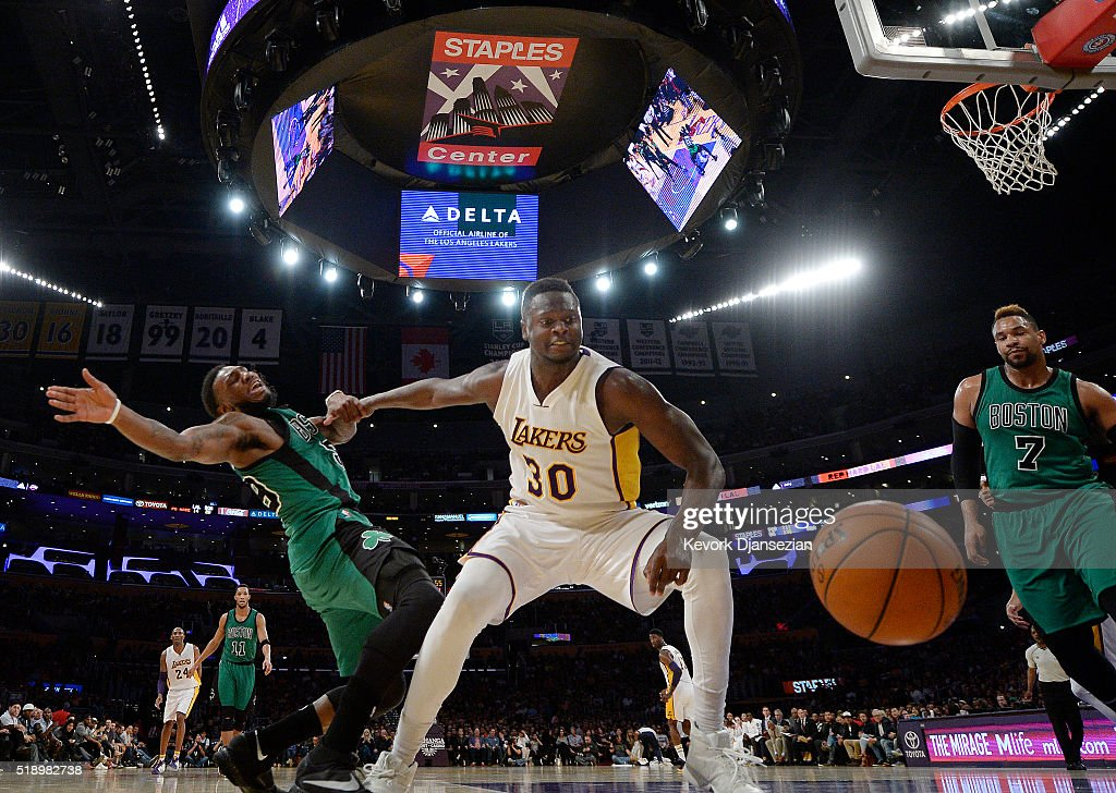 Julius Randle #30 of the Los Angeles Lakers and Jae Crowder #99 of the Boston Celtics battle for the basketball during the first half of the basketball game at Staples Center April 3, 2016, in Los Angeles, California.
