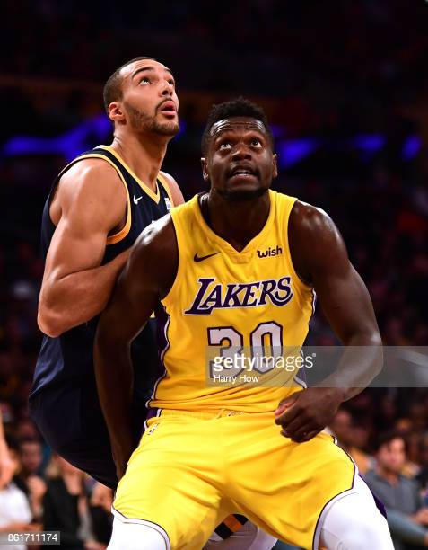 Julius Randle of the Los Angeles Lakers and Rudy Gobert of the Utah Jazz push for postion at Staples Center on October 10 2017 in Los Angeles...