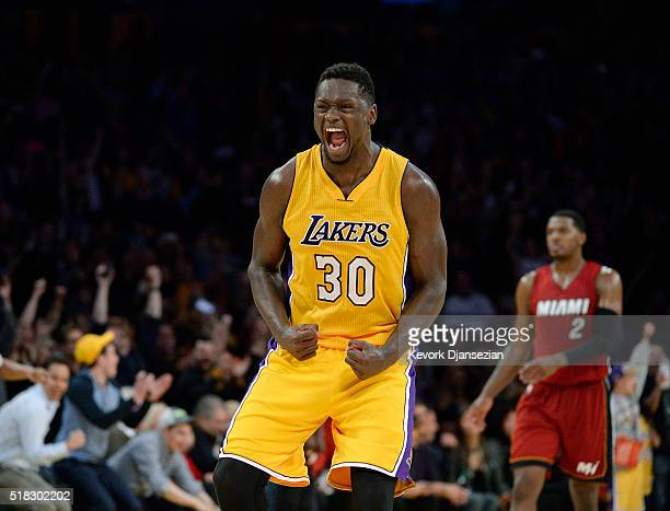 Julius Randle of the Los Angeles Lakers celebrates after defeating the Miami Heat102100 in overtime at Staples Center March 30 in Los Angeles...