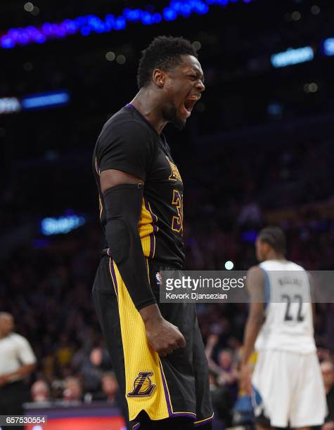 Julius Randle of the Los Angeles Lakers celebrates after scoring basket against Minnesota Timberwolves in overtime of the basketball game at Staples...