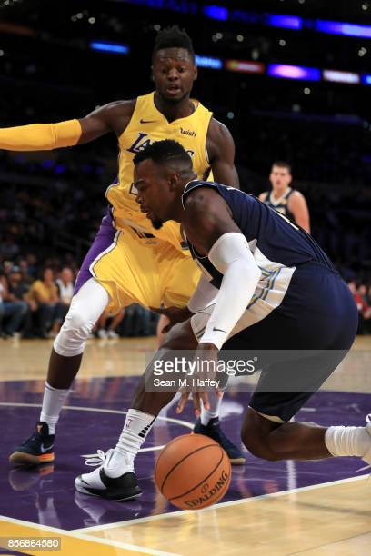 Julius Randle of the Los Angeles Lakers defends against Paul Millsap of the Denver Nuggets during the first half of a preseason game at Staples...