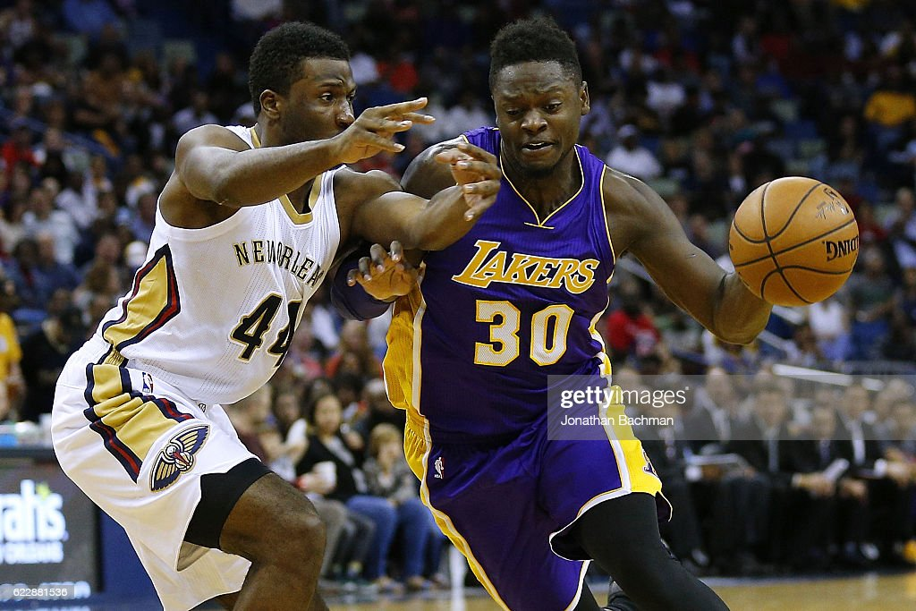 Julius Randle #30 of the Los Angeles Lakers drives against Solomon Hill #44 of the New Orleans Pelicans during the second half of a game at the Smoothie King Center on November 12, 2016 in New Orleans, Louisiana.