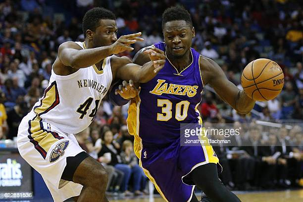 Julius Randle of the Los Angeles Lakers drives against Solomon Hill of the New Orleans Pelicans during the second half of a game at the Smoothie King...