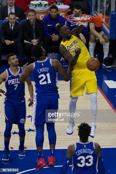 Julius Randle of the Los Angeles Lakers dunks the ball against Joel Embiid of the Philadelphia 76ers in the first quarter at the Wells Fargo Center...