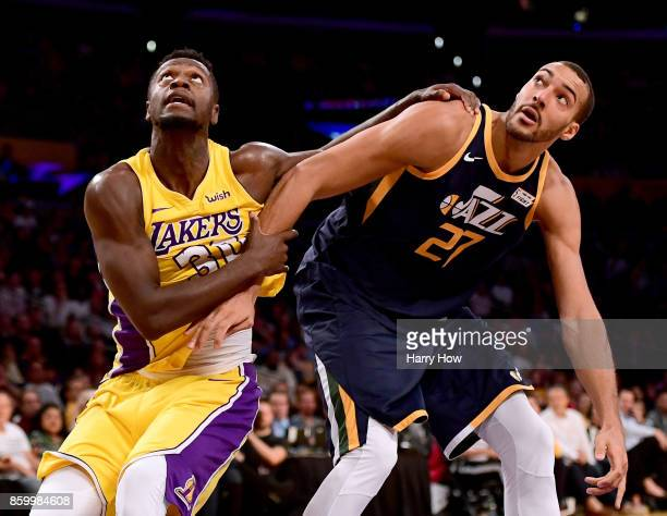 Julius Randle of the Los Angeles Lakers fouls Rudy Gobert of the Utah Jazz during the fourth quarter in a 10599 Jazz win at Staples Center on October...