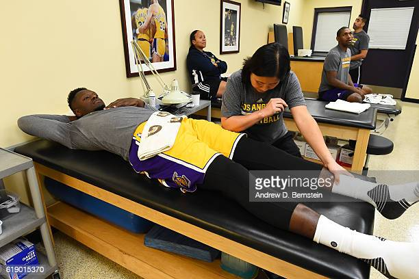 Julius Randle of the Los Angeles Lakers gets treatment before the game against the Houston Rockets on October 26 2016 at STAPLES Center in Los...