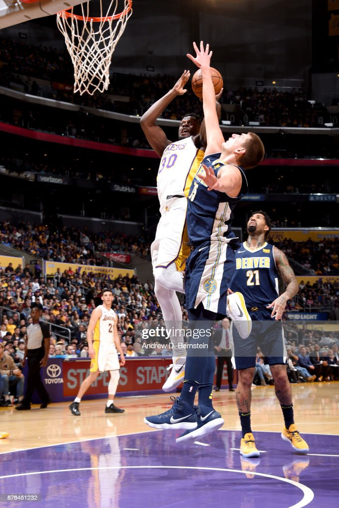 Julius Randle #30 of the Los Angeles Lakers goes to the basket against the Denver Nuggets on November 19, 2017 at STAPLES Center in Los Angeles, California.