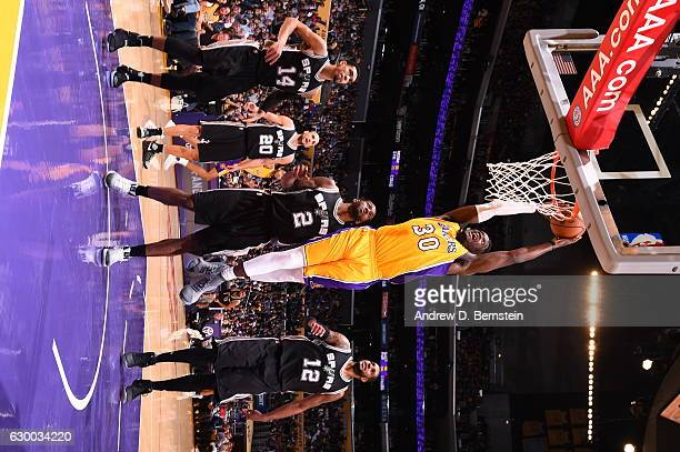 Julius Randle of the Los Angeles Lakers goes up for a dunk against the San Antonio Spurs on November 18 2016 at STAPLES Center in Los Angeles...
