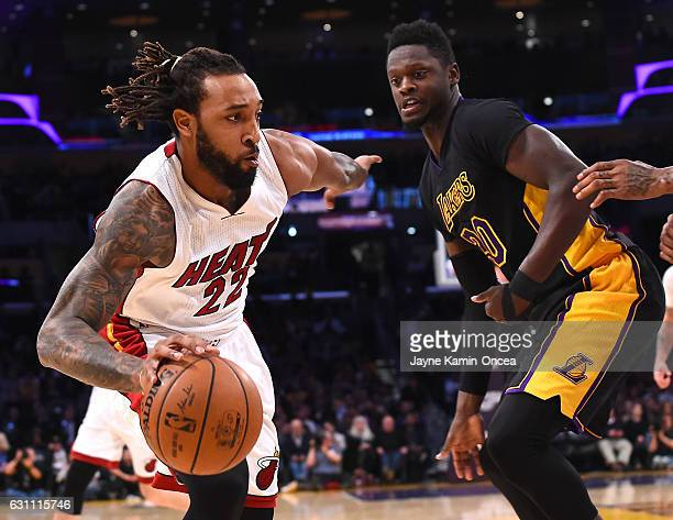 Julius Randle of the Los Angeles Lakers guards Derrick Williams of the Miami Heat as he drives to the basket in the first half of the game at Staples...