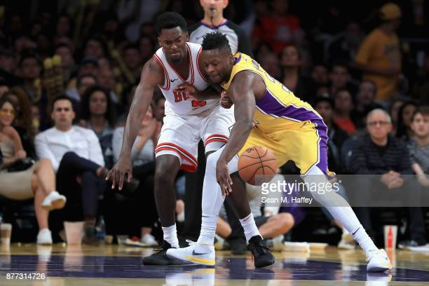 Julius Randle of the Los Angeles Lakers steals the ball from Bobby Portis of the Chicago Bulls during the second half of a game at Staples Center on...