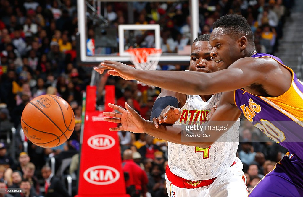 <a gi-track='captionPersonalityLinkClicked' href=/galleries/search?phrase=Julius+Randle&family=editorial&specificpeople=10784969 ng-click='$event.stopPropagation()'>Julius Randle</a> #30 of the Los Angeles Lakers strips the ball from <a gi-track='captionPersonalityLinkClicked' href=/galleries/search?phrase=Paul+Millsap&family=editorial&specificpeople=880017 ng-click='$event.stopPropagation()'>Paul Millsap</a> #4 of the Atlanta Hawks at Philips Arena on December 4, 2015 in Atlanta, Georgia. NOTE TO USER User expressly acknowledges and agrees that, by downloading and or using this photograph, user is consenting to the terms and conditions of the Getty Images License Agreement.