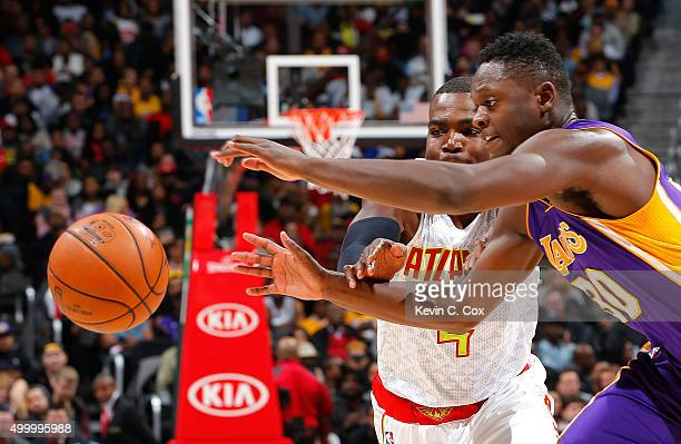 Julius Randle of the Los Angeles Lakers strips the ball from Paul Millsap of the Atlanta Hawks at Philips Arena on December 4 2015 in Atlanta Georgia...
