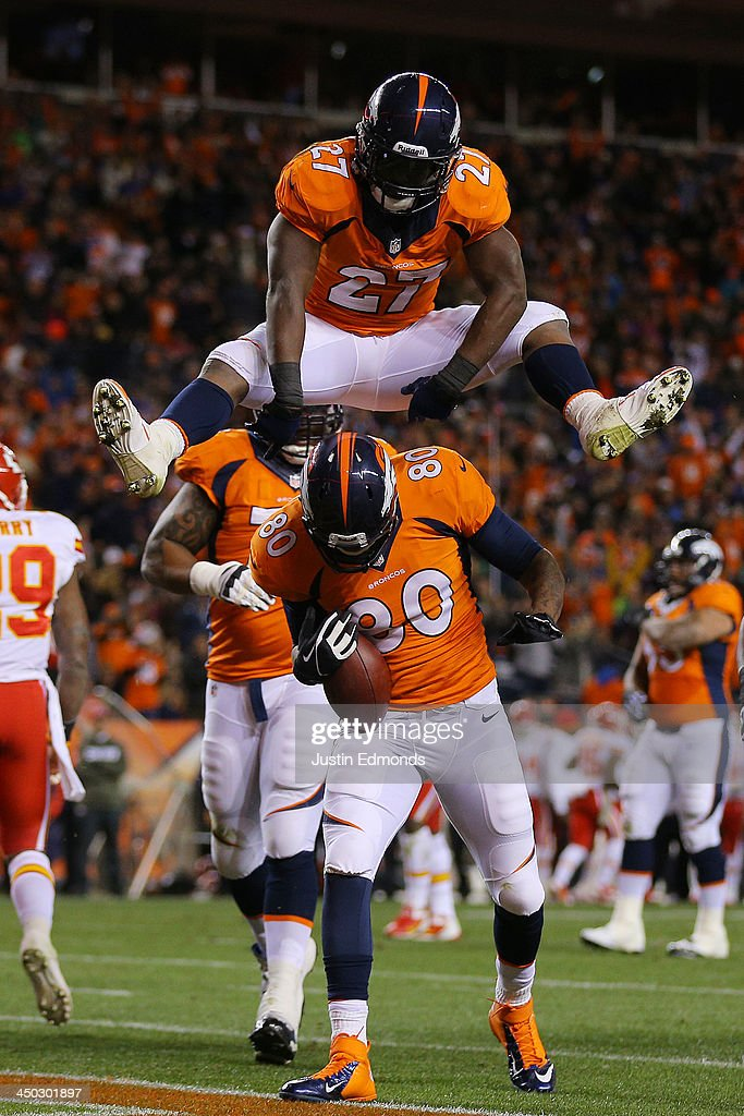 Julius Thomas #80 celebrates hjis first quarter touchdown against the Kansas City Chiefs with <a gi-track='captionPersonalityLinkClicked' href=/galleries/search?phrase=Knowshon+Moreno&family=editorial&specificpeople=3986554 ng-click='$event.stopPropagation()'>Knowshon Moreno</a> #27 of the Denver Broncos at Sports Authority Field at Mile High on November 17, 2013 in Denver, Colorado.