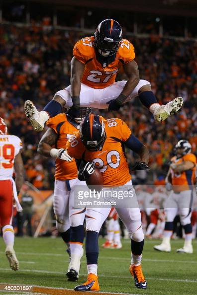 Julius Thomas celebrates hjis first quarter touchdown against the Kansas City Chiefs with Knowshon Moreno of the Denver Broncos at Sports Authority...