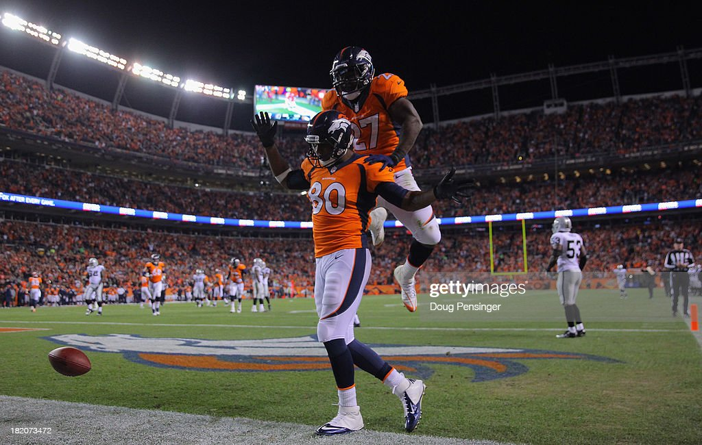 Julius Thomas #80 of the Denver Broncos celebrates his touchdown against the Oakland Raiders with <a gi-track='captionPersonalityLinkClicked' href=/galleries/search?phrase=Knowshon+Moreno&family=editorial&specificpeople=3986554 ng-click='$event.stopPropagation()'>Knowshon Moreno</a> #27 of the Denver Broncos at Sports Authority Field at Mile High on September 23, 2013 in Denver, Colorado.