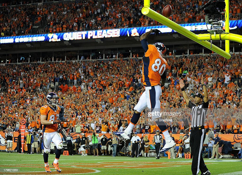 Julius Thomas #80 of the Denver Broncos celebrates in front of teammate <a gi-track='captionPersonalityLinkClicked' href=/galleries/search?phrase=Wes+Welker&family=editorial&specificpeople=236127 ng-click='$event.stopPropagation()'>Wes Welker</a> #83 of the Denver Broncos following a 24-yard touchdown pass against the Baltimore Ravens in the second quarter during the game at Sports Authority Field at Mile High on September 5, 2013 in Denver Colorado.
