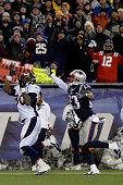 Julius Thomas of the Denver Broncos makes a touchdown catch over the outstretched hand of Patrick Chung of the New England Patriots during the second...
