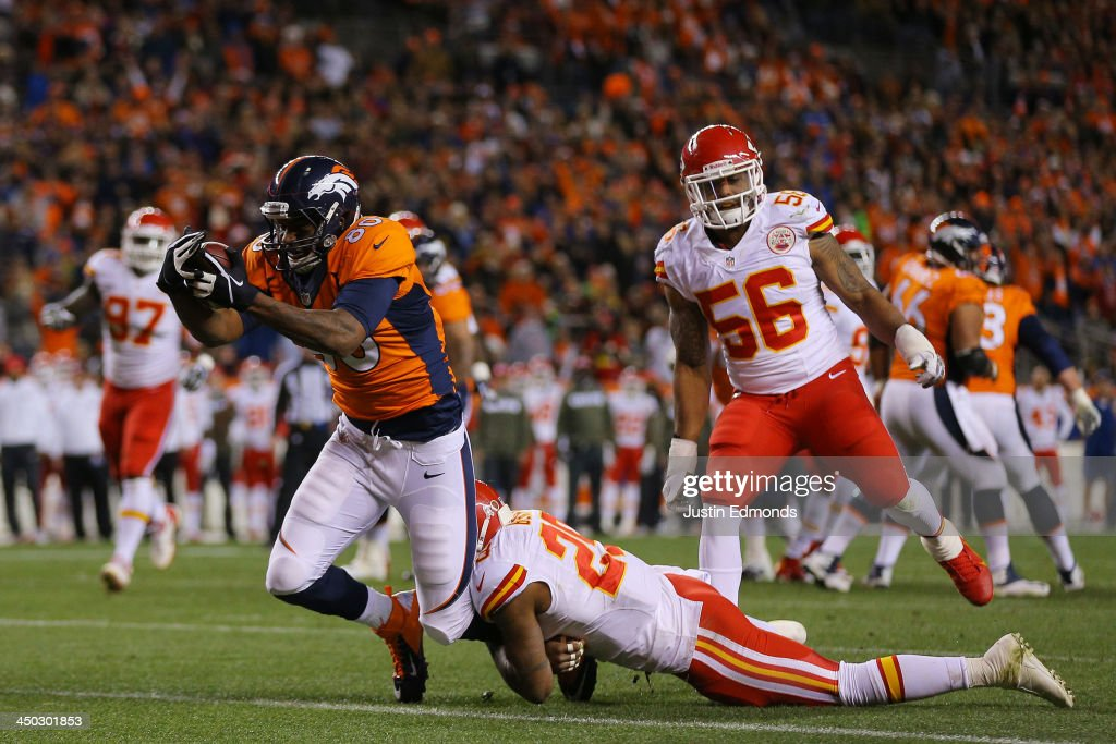 Julius Thomas #80 of the Denver Broncos scores a first quarter touchdown against the defense of <a gi-track='captionPersonalityLinkClicked' href=/galleries/search?phrase=Eric+Berry+-+American+Football+Player&family=editorial&specificpeople=4501099 ng-click='$event.stopPropagation()'>Eric Berry</a> #29 of the Kansas City Chiefs at Sports Authority Field at Mile High on November 17, 2013 in Denver, Colorado.