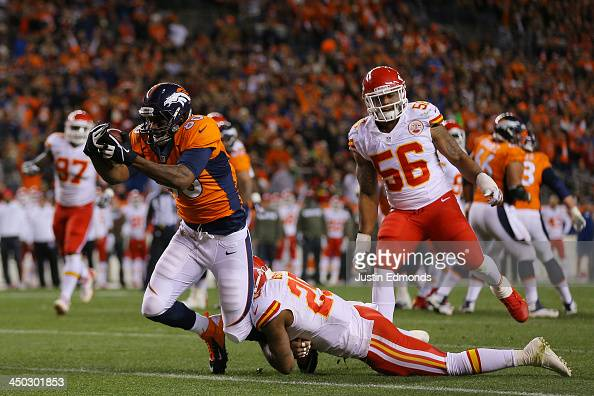 Julius Thomas of the Denver Broncos scores a first quarter touchdown against the defense of Eric Berry of the Kansas City Chiefs at Sports Authority...