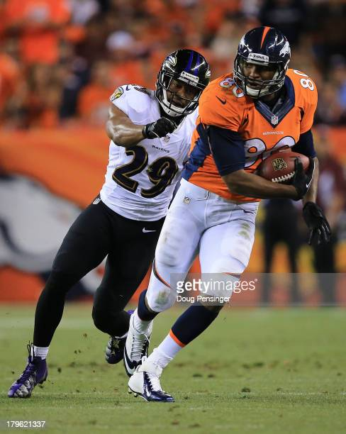 Julius Thomas of the Denver Broncos shakes off Michael Huff of the Baltimore Ravens before running in for a 24yard touchdown in the second quarter...