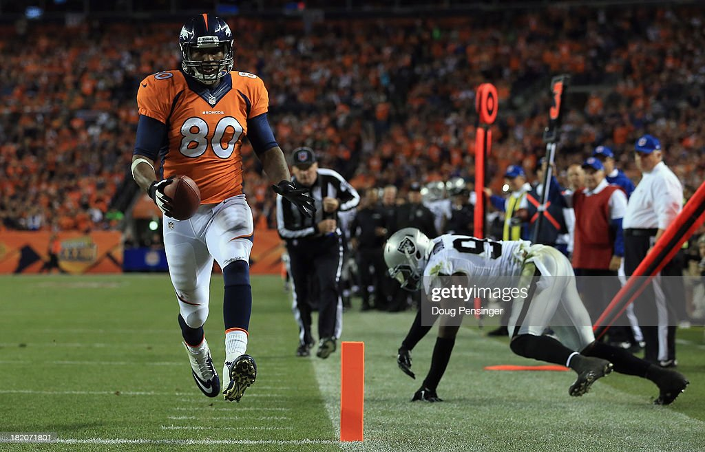 Julius Thomas #80 of the Denver Broncos sheds <a gi-track='captionPersonalityLinkClicked' href=/galleries/search?phrase=Kevin+Burnett&family=editorial&specificpeople=756587 ng-click='$event.stopPropagation()'>Kevin Burnett</a> #94 of the Oakland Raiders for a touchdown reception at Sports Authority Field at Mile High on September 23, 2013 in Denver, Colorado.