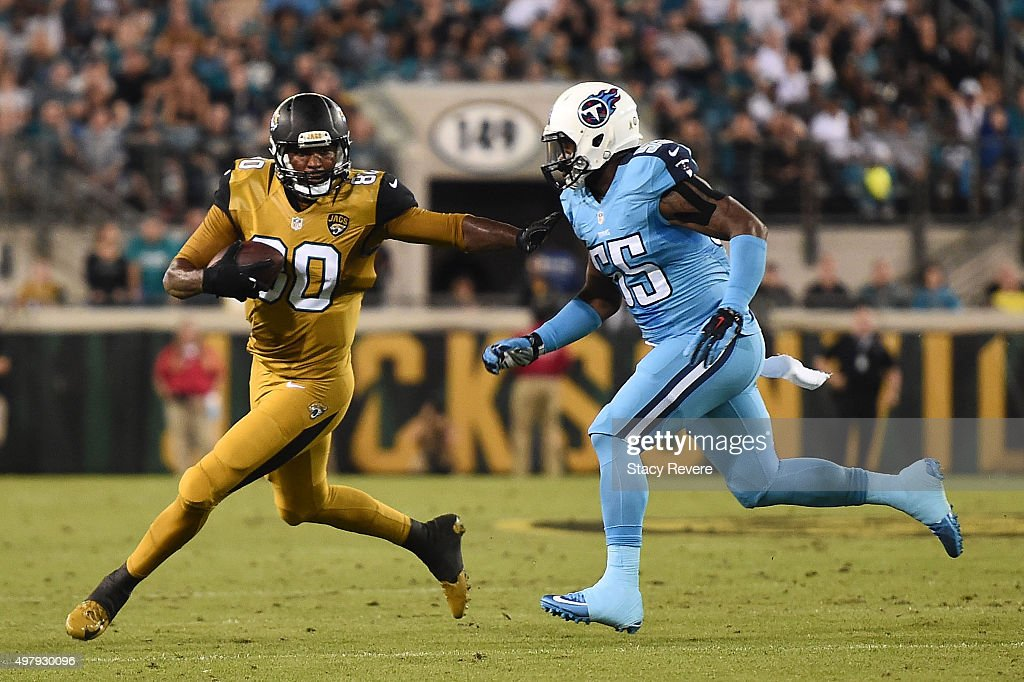 Julius Thomas #80 of the Jacksonville Jaguars is pursued by Zach Brown #55 of the Tennessee Titans during the first quarter of a game at EverBank Field on November 19, 2015 in Jacksonville, Florida.