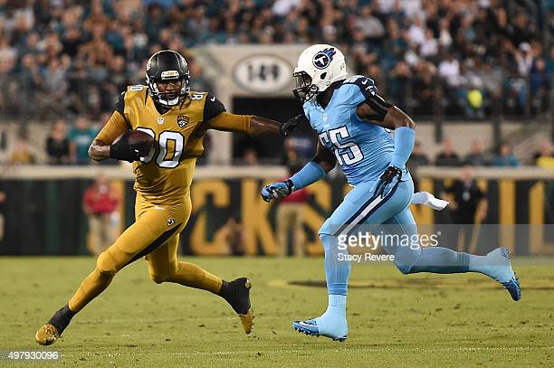Julius Thomas of the Jacksonville Jaguars is pursued by Zach Brown of the Tennessee Titans during the first quarter of a game at EverBank Field on...