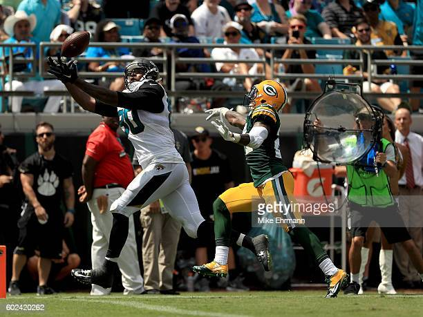Julius Thomas of the Jacksonville Jaguars makes a touchdown catch during the game against the Green Bay Packers at EverBank Field on September 11...