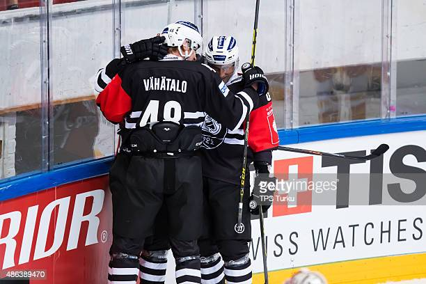 Julius Vähatalo Tero Koskiranta and Tomi Kallio celebrates goal during the Champions Hockey League group stage game between TPS Turku and...