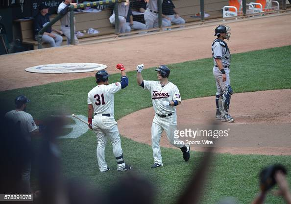 Minnesota Twins Left field Josh Willingham hit a home run and celebrate with Minnesota Twins Right field Oswaldo Arcia during the game between the...