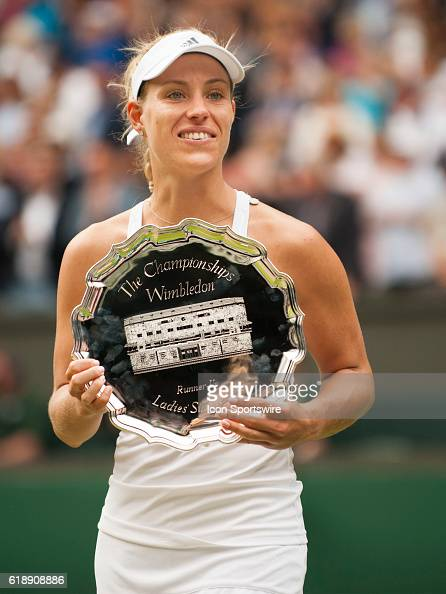 Angelique Kerber with runnerup trophy after loosing to Serena Williams during the women's singles final during The Championships Wimbledon at the All...