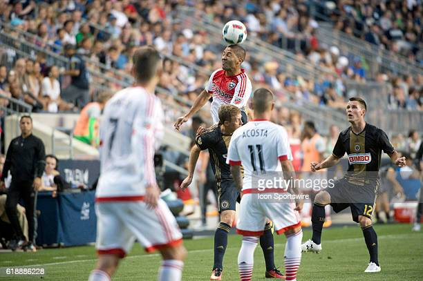 DC United Forward Álvaro Saborío heads the ball over Union Midfielder Brain Carroll in the second half during the game between the Philadelphia Union...