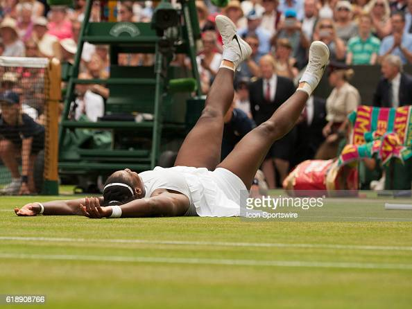 Serena Williams falls to the court after winning the women's singles title during The Championships Wimbledon at the All England Lawn Tennis and...