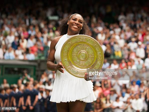Serena Williams poses with the trophy after winning the women's singles title during The Championships Wimbledon at the All England Lawn Tennis and...